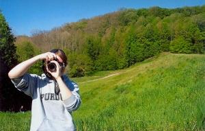 My face is often hidden behind a camera.