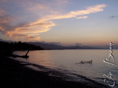 Black sand beach at sunset, near Port Antonio.