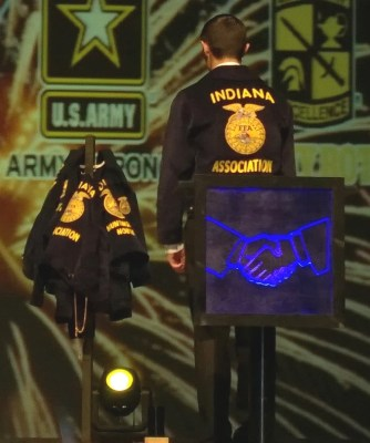 Standing sentinel over his teammate's FFA jackets. The clasping hands is the symbol of the sentinel, and it's the symbol I stood by during my time as an officer.