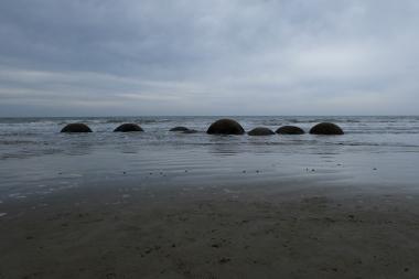 Boulders in the Pacific Ocean, part of the Moeraki Boulders.
