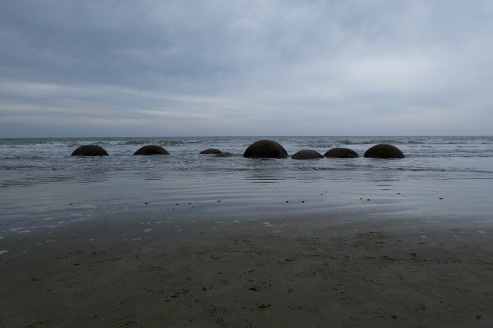 Boulders in the Pacific Ocean, part of the Moeraki Boulders.