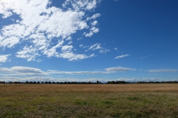 The dry grasses, wide open skies and, in the distance, the majestic Southern Alps (Misty Mountains) of Canterbury, all seen from Christchurch.